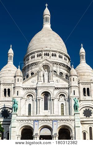 The Basilica of the Sacred Heart of Jesus (Basilique du Sacre-Coeur) on Montmartre hill, Paris