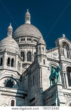 The Basilica of the Sacred Heart of Jesus (Basilique du Sacre-Coeur) on Montmartre hill Paris, France