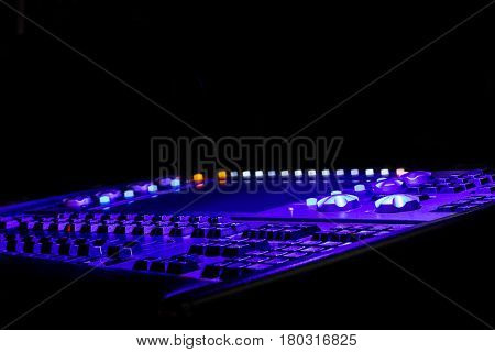 Purple and blue light mixer for a scene with a display