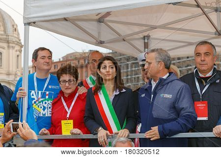 Rome Italy - April 2nd 2017: The stage with the authorities present at the marathon at the center we see the mayor Virginia Raggi with the tricolor flag.