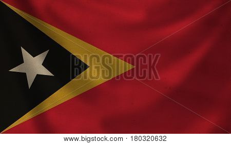 Vintage background with flag of East Timor. Grunge style.
