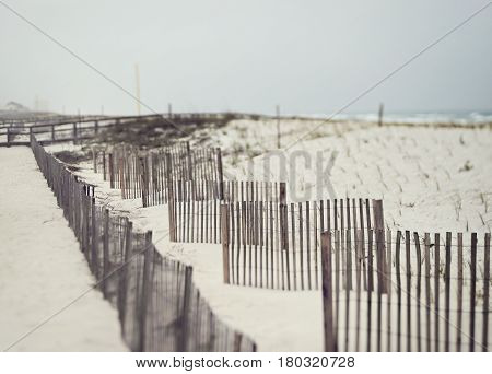 Beautiful beach on a stormy day in Florida on the Gulf of Mexico with sand fences to prevent erosion.