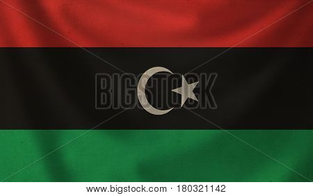 Vintage background with flag of Libya. Grunge style.
