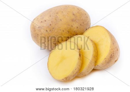 ripe potato tubers with cut slices isolated on white stacked image all in focus