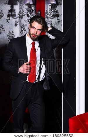 Bearded Man, Businessman In Suit And Red Tie Against Wallpaper