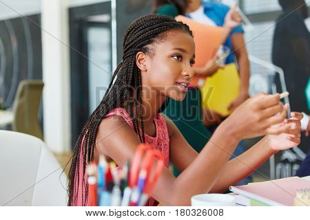 African woman in workshop as student in apprenticeship