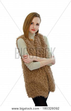 An image of a beautiful young girl in a vest an artificial fur