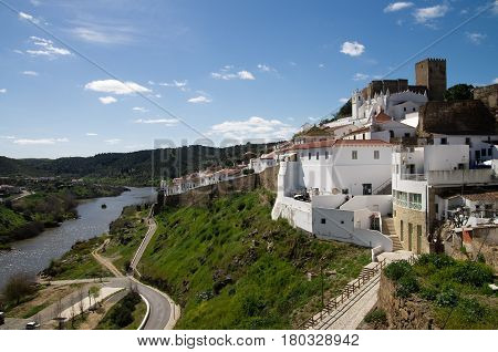 Mertola Castle And Town Facing Guadiana River.