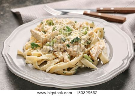 Plate with delicious Chicken Alfredo on table