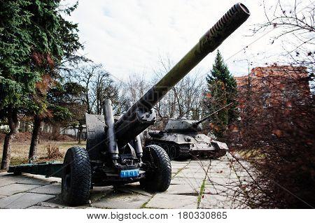 Old Vintage Military Howitzer At City Pedestal.
