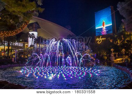 LAS VEGAS - JAN 15 : Fountains in front of the entrance to the Wynn Hotel and Casion on January 08 2017 in Las Vegas. The hotel has 2716 rooms and it opened in 2005.