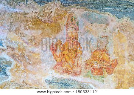 SIGIRIYA SRI LANKA - NOVEMBER 27 2016: The ancient frescoes on the way to Sigiriya Fortress along the Mirror Wall on November 27 in Sigiriya.