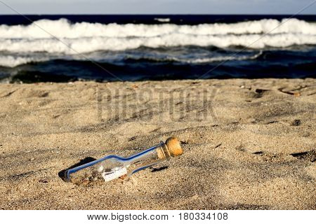 Bottle with a letter on the sandy shore of the Black Sea of Bulgaria