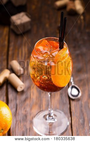 A glass of sparkling wine Aperol with soda and orange