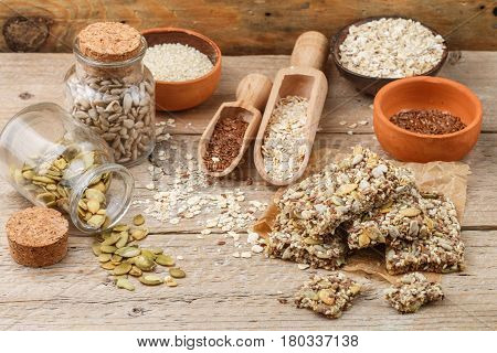 Healthy Snack - Crispy Cereal Cookies On Old Wooden Table And Ingredients: Oat Flakes, Flax Seed, Pu