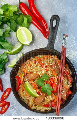 Starch (rice, potatoes) noodles with beef and vegetables - bell peppers, carrots, zucchini, sesame seeds, lime, chili, cilantro and soy sauce. A delicious dinner in the Asian style poster