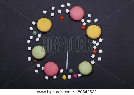 Colorful Macaron, Dragee Sweets, Marshmallow, Zephyr, And Candles