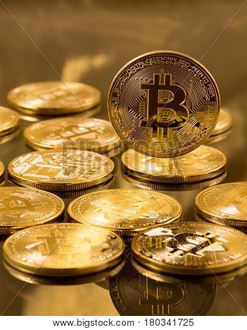 Stack of bit coins or bitcoin on gold background to illustrate blockchain and cyber currency