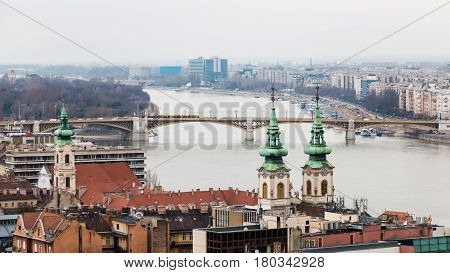 Cityscape of Budapest and Danube river with haze on the horizon after the rain