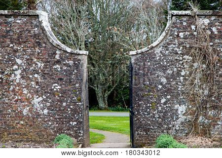 Old stone wall with gateway in country park estate