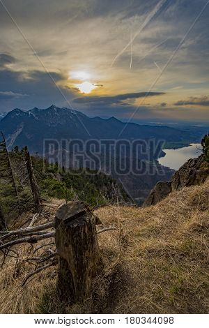 Beautifull lake view from mountain in german alps with rocks and trees on a foreground