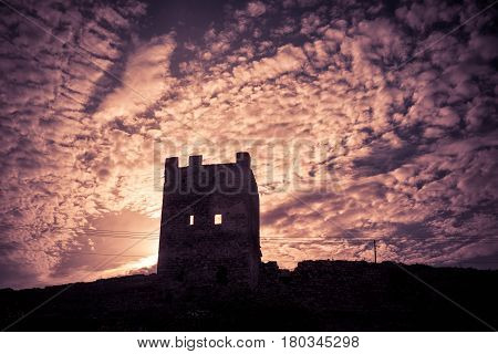 Ruins of the Genoese fortress in the city of Feodosia at sunset, Crimea, Russia