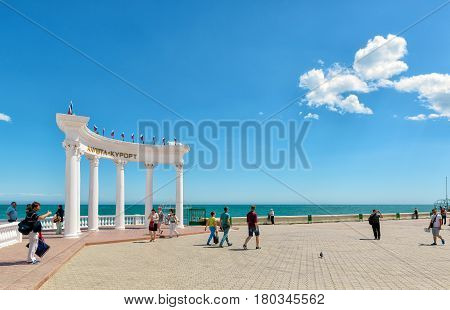 ALUSHTA, RUSSIA - MAY 15, 2016: Tourists walk along the promenade in the resort city of Alushta in Crimea. The Rotunda