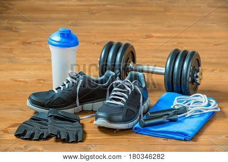 Sports Facilities And Shoes For Men On The Wooden Floor