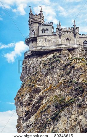 Swallow's Nest castle on the rock over the Black Sea in Crimea, Russia. Low angle view. This castle is a symbol of Crimea.
