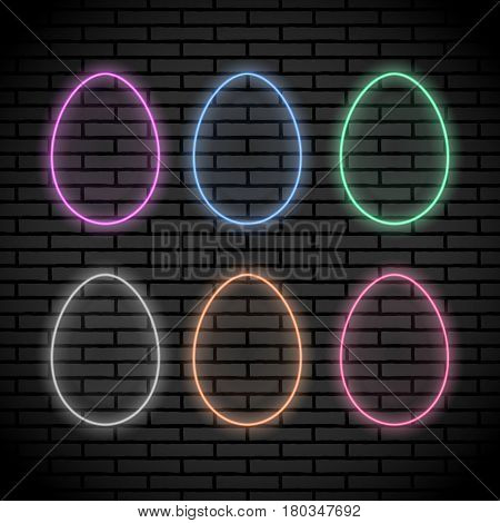 Set of egg shaped neon lights isolated on the brick wall background. Vector elements illustration for the design purposes