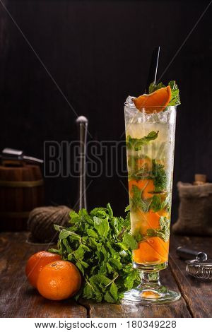 Mojito tangerine. Cocktail with white rum, lemon juice, sugar syrup, soda, tangerine and mint