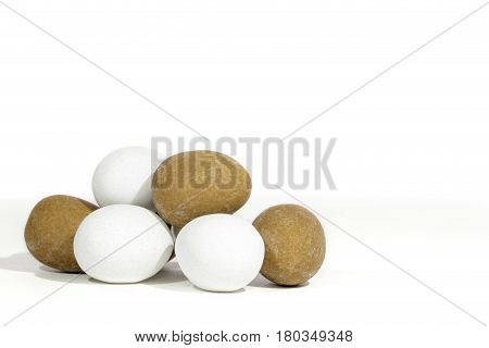 Pile of mini Easter eggs. Hand made sugar-coated candy truffles against white background with copy space.
