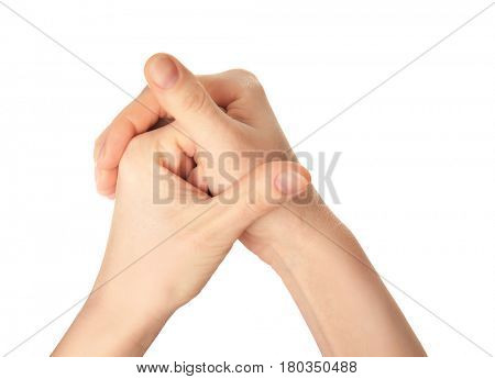 Hands of young woman suffering from pain in joints on white background
