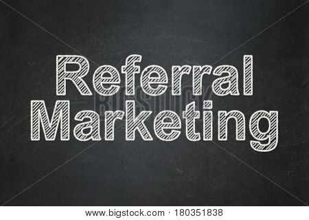 Advertising concept: text Referral Marketing on Black chalkboard background