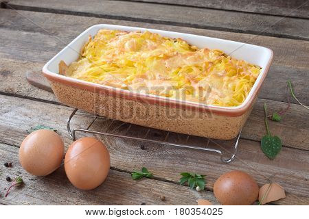 Baked pasta gratin with cheese in a casserole.