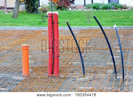 Plastic Conduits Installed in new Building House Foundations. Water Sewer and Electric Conduits.