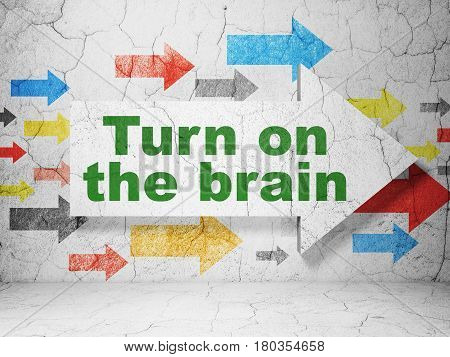 Learning concept:  arrow with Turn On The Brain on grunge textured concrete wall background, 3D rendering