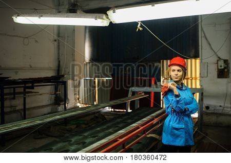 Beautiful Woman In Red Safety Helmet Work As Industrial Worker