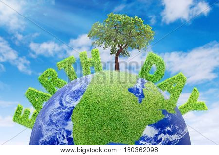 Image of Earth Day text with a tree and green grass on a globe. Earth Day concept