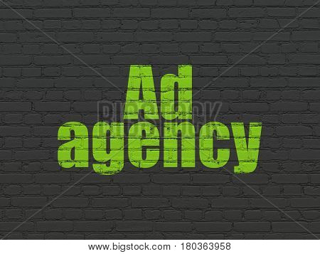 Advertising concept: Painted green text Ad Agency on Black Brick wall background