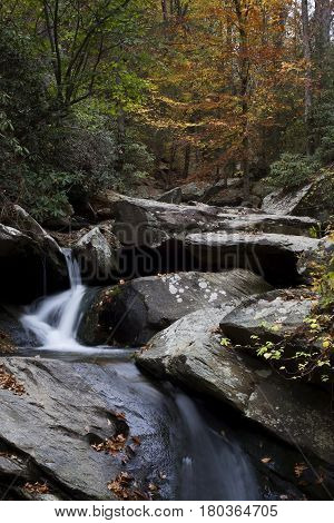 Water cascades over rocks and boulders during autumn near Ocoee, Tennessee