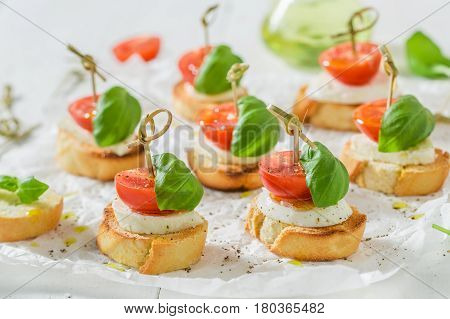 Tasty Crostini Made With Mozzarella And Tomato For A Snack