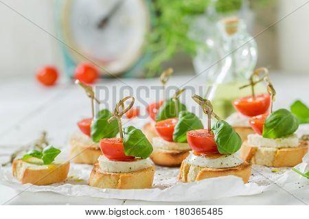 Tasty Crostini With Tomato, Mozzarella And Basil For A Snack