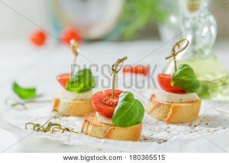 Crisp Crostini Made With Mozzarella And Tomato For A Snack