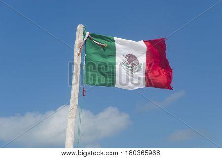 Mexican flan waving on beach caribbean sea