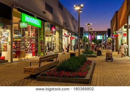 ASHDOD, ISRAEL - JULY 03, 2016: Shops and boutiques in open air mall at evening - owned by BIG Shopping Centers Ltd., founded in 1994, operates in four countries - Israel, USA, India and Serbia.