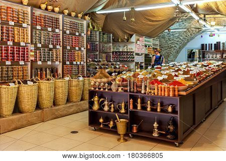 JERUSALEM, ISRAEL - JULY 04, 2016: Interior view of spice shop on bazaar in Old City of Jerusalem - famous market place with shops and restaurants offering traditional food, spices and souvenirs.