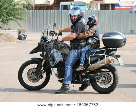 Father And Small Boy On Bmw Motorbike