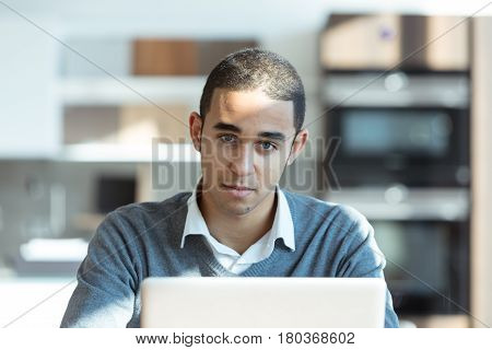 Young Man At Computer In Office