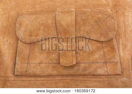 Detail of suede interior of antique leather suitcase